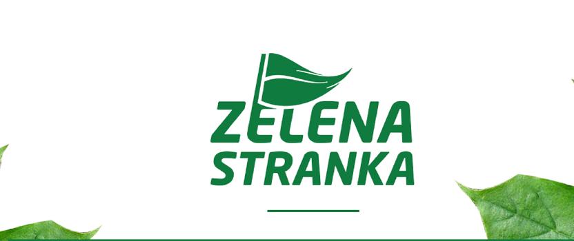 Polomljena i odvaljena tabla sa natpisom Zelene stranke u centru Beograda
